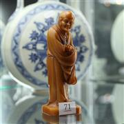 Sale 8362 - Lot 71 - Chinese Yellow Stone Carved Monk , marks to back, H16cm