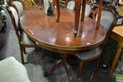 Sale 8480 - Lot 1062 - An Oval Dining Table