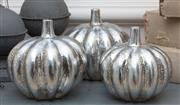 Sale 8866H - Lot 86 - A pair of silvered pumpkins and a smaller example, the larger Height 15cm