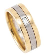 Sale 8879 - Lot 388 - A GENTS 18CT TWO TONE GOLD DIAMOND RING; 8mm wide triple band set with a baguette cut diamond, size U, wt. 13.83g.