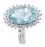 Sale 9066A - Lot 13 - A 14CT WHITE GOLD AQUAMARINE AND DIAMOND CLUSTER RING; claw set with an oval cut aquamarine of approx. 4.90ct to a surround of 24 ro...