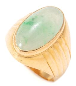 Sale 9164J - Lot 372 - A 20CT GOLD JADE RING; rub set with a 19 x 10mm cabochon variegated light green jade to reeded shoulders, size Q, wt. 9.46g.