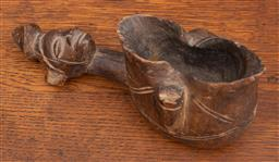 Sale 9160H - Lot 204 - An African figural handled loving cup, with mask to front, Length 22cm