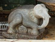 Sale 8838H - Lot 2 - A stone figure of a crouching baby elephant on a rectangular base. Height 32 x Width 34 x Depth 28cm