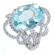 Sale 8915 - Lot 391 - AN 18CT WHITE GOLD AQUAMARINE AND DIAMOND RING; featuring an oval cut aquamarine of approx. 6.63ct to scrolling pierced surround and...