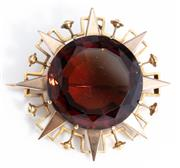 Sale 8960J - Lot 53 - A large antique 18ct gold pendant brooch C:1890, the large dark citrine claw set within a star burst frame above a geometric and bal...