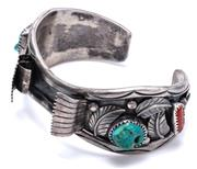 Sale 9020 - Lot 319 - A VINTAGE AMERICAN INDIAN SILVER TURQUOISE AND CORAL CUFF BANGLE; 25mm wide cuff applied with leaf motifs and cut down claw set with...