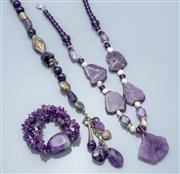 Sale 9037F - Lot 62 - TWO AMETHYST BEAD NECKLACES AND A BRACELET; 1 round and faceted beads to silver tone beads and toggle clasp, length 47cm, other poli...