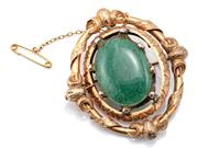 Sale 9083 - Lot 573 - AN ANTIQUE GOLD STONE SET BROOCH; centring a spinning locket compartment later replaced with a 28 x 22mm green oval aventurine quart...