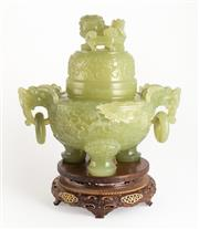 Sale 8536 - Lot 79 - A light Green Jade Censer and Cover in Qing Dynasty style. The intricately carved globular body supported on three clawed-animal fee...