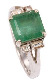 Sale 8937 - Lot 448 - A 14CT WHITE GOLD EMERALD AND DIAMOND RING; centring an approx. 1.40ct square emerald cut emerald to split shoulders each set with a...