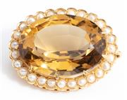 Sale 8960J - Lot 54 - An antique 15ct gold brooch, C: 1880, claw set to the centre with a large and deep cut citrine of a good lively golden colour, frame...