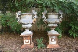 Sale 9135H - Lot 172 - A fine pair of old versailles style cast iron urns and plinths, with weathered patina. 1.4M Height, 80cm width