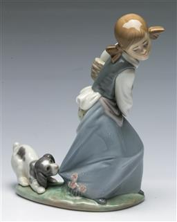 Sale 9164 - Lot 471 - Lladro figure of A girl with dog nipping at her dress (H 21.5cm)