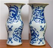 Sale 8270 - Lot 26 - A pair of Chinese blue and white vases, dragons and phoenix design, Xianfeng marks to base, h 35cm