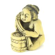 Sale 8304A - Lot 65 - Ivory Carved Erotic Netsuke of a Woman Washing Her Clothes
