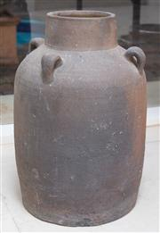 Sale 8550H - Lot 165 - A round dark brown clay jar with four handles and a hole for a tap near base, H 38 x Diam 25cm