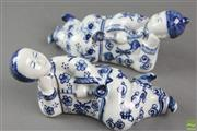 Sale 8599 - Lot 47 - Blue and White Pair of Chinese Porcelain Figures Reclining