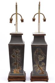 Sale 8897 - Lot 48 - A pair of interesting metal lamp bases of Oriental influence with embossed detail showing butterflies and birds amongst foliage, rai...