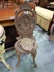 Sale 8653 - Lot 1048 - Victorian Cast Iron Garden Chair, the back with a farmer sowing allegorical of spring, design originally registered by Morgan, Macau...