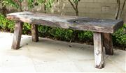 Sale 8838H - Lot 6 - A rustic wooden bench. Height 42 x Width 135cm