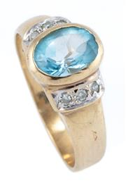 Sale 8928 - Lot 301 - A 9CT GOLD TOPAZ AND DIAMOND RING; rub set with a blue oval topaz and 6 single cut shoulder diamonds, size N, wt. 3.19g.