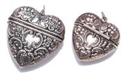 Sale 9010H - Lot 71 - Two sterling silver heart shaped lockets/pendants with hinged lids and a repousse design to front and back