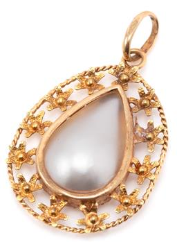 Sale 9149 - Lot 544 - AN 18CT GOLD PEARL PENDANT; featuring a drop shape mother of pearl to pierced floral frame, size 39 x 22mm, wt. 3.82g.