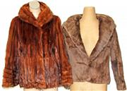 Sale 8173F - Lot 345 - TWO VINTAGE FUR JACKETS; short 1950s coney jacket (S), and 1960s pachinski, damaged (M).