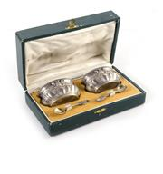 Sale 8224A - Lot 39 - A French boxed set of silver plated salts with glass liners and serving spoons, salts size 4 x 6 cm