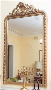 Sale 9055H - Lot 6 - A continental ornately carved and gilt timber-framed mirror with shell and acanthus and pediment. H:160cm (approx.) W:100cm