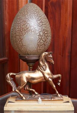 Sale 9103H - Lot 2 - A vintage bedside lamp with a stepping horse base and amber shade, Total Height 37cm x Width 23cm