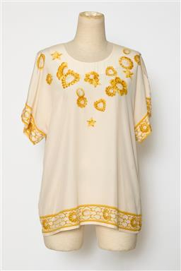 Sale 9095F - Lot 85 - An Escada short sleeved cream patterned silk top with yellow flowers, size 40.