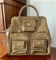 Sale 8849P - Lot 634 - An olive green patent leather handbag with three pockets to front, Height 35cm x Width 43cm