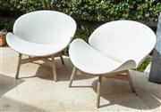 Sale 8838H - Lot 4 - A pair of outdoor Dansk chairs upholstered in a white vinyl on teak legs joined by an x-frame, stamped Gloster to back