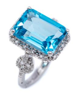 Sale 9194 - Lot 336 - A SILVER TOPAZ AND STONE SET COCKTAIL RING; featuring an emerald cut blue topaz of approx. 8.98ct to surround and circle shoulders s...