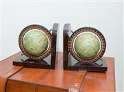 Sale 8308A - Lot 130 - A pair of bookends, each displaying a printed paper globe of the ancient world. Ht: 15cm