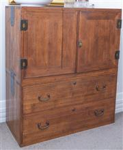Sale 8800 - Lot 169 - A Japanese elm two door cupboard on chest, with two drawers, and brass hardware, H 119 x W 94 x D 42cm