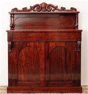 Sale 8912H - Lot 21 - An antique English mahogany small sideboard C: 1865, the scroll carved back above a shelf raised on vase turned supports. The full w...