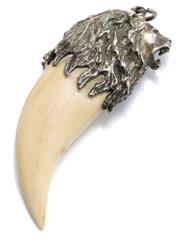 Sale 8946 - Lot 334 - A VINTAGE SILVER AND IVORY LION PENDANT; tooth/claw shaped ivory applied with a silver lion head with mane, length 7cm, wt. 31.72g.