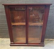 Sale 9048 - Lot 1037 - Mid-19th Century Cedar Dwarf Bookcase, with two glass penal doors enclosing peg adjusted shelves, having pilasters & raised on a low...