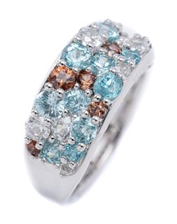 Sale 9194 - Lot 536 - A SILVER MULTI COLOUR ZIRCON RING; set with round cut blue, brown and white zircons, width 10mm, size N1/2, wt. 6.22g.
