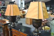 Sale 8291 - Lot 1007 - Pair of Black Chinoiserie Table Lamps, painted with pagodas with parchment shades (damaged)