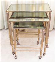 Sale 8346A - Lot 33 - A nest of three brass and glass tables on castors