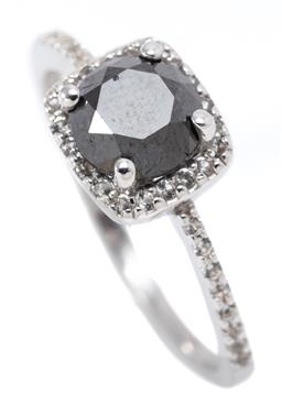 Sale 9164J - Lot 460 - A BLACK DIAMOND RING; set in silver with a tall round brilliant cut black diamond of approx. 1.30ct to cushion shape surround and sh...
