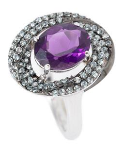 Sale 9186 - Lot 333 - A SILVER AMETHYST AND STONE SET RING; 4 claw set with an oval cut amethyst to spiral surround set with round cut topaz (1 missing),...