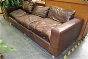 Sale 8156 - Lot 1033 - Leather Three Seater Lounge - Repair to Leg
