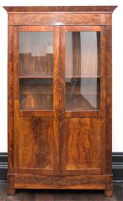 Sale 8222 - Lot 7 - A walnut mahogany veneered two door bookcase, with glass doors and shelved interior, H 216, W 130, D 38cm Film Provenance; Austral...