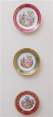 Sale 8430 - Lot 8 - Three Limoges plates printed with scenes after Fragonard. Diameter 24cm.