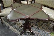 Sale 8500 - Lot 1005 - Unusual Victorian Walnut Games Table, the square top with four drop-leaves, banded in burr walnut & with olive leather panels, conce...